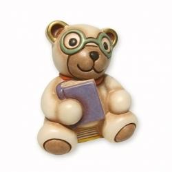 Teddy con occhiali seduto su libri - Thun
